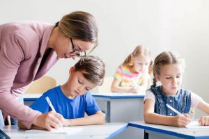 Teacher-helping-students-use-First-Then-visuals-in-a-special-education-classroom